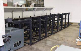 CSNC-65 machine bar loader back view